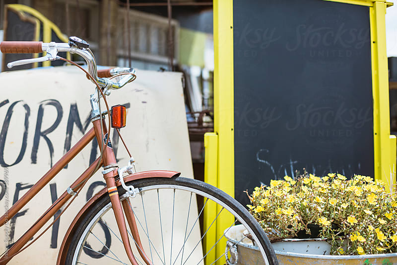 chalk board, flowers  and bike outside by Image Supply Co for Stocksy United