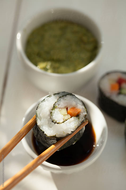 Vegetarian sushi on the table. by Mosuno for Stocksy United