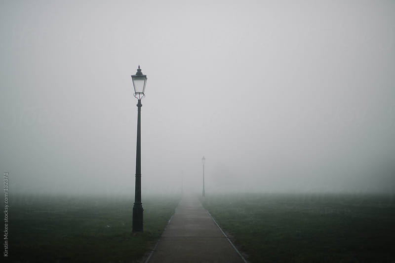London lamp post in the fog by Kirstin Mckee for Stocksy United