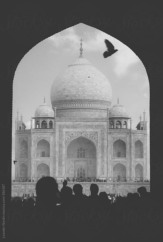 Taj Mahal with silhouettes from people by Leander Nardin for Stocksy United