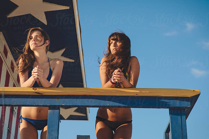 Young Women Friends in Bikini Swimsuit Hanging Out in Lifeguard Hut in South Beach Miami by Joselito Briones for Stocksy United