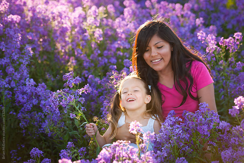 Beautiful little girl and au pair in field of lavender by Brian McEntire for Stocksy United