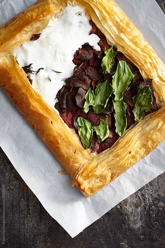 Homemade beet pastry with basil and yogurt by Paperclip Images for Stocksy United