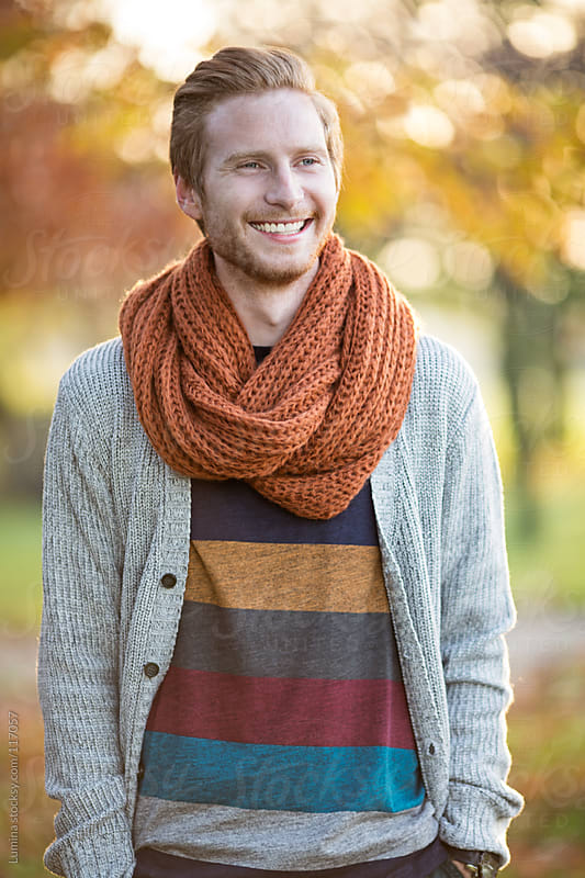 Smiling Man Outdoors on an Autumn Day by Lumina for Stocksy United