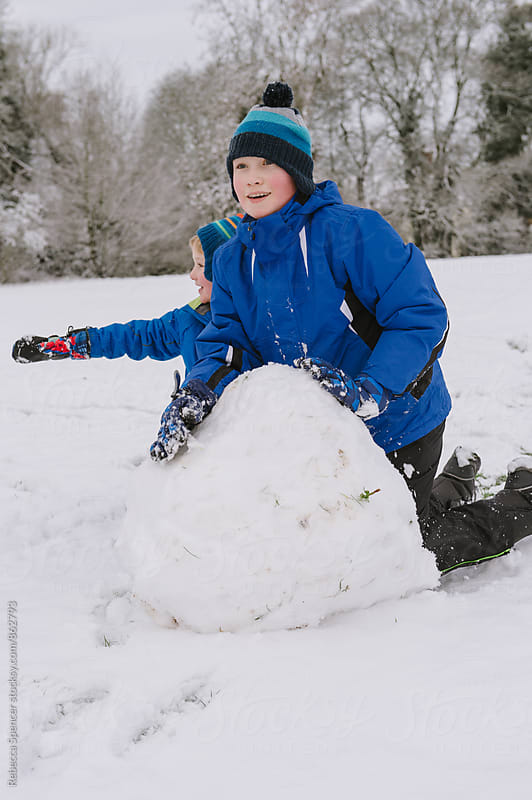 Brothers enjoying the snow by Rebecca Spencer for Stocksy United