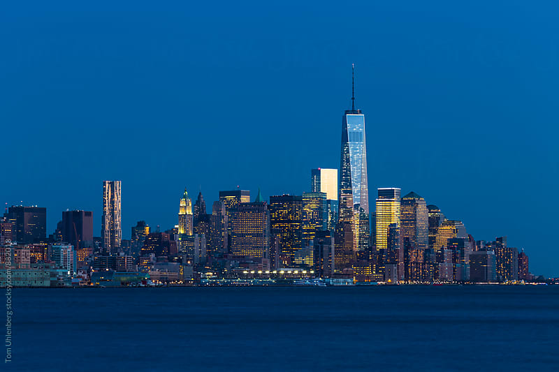 Lower Manhattan Skyline at the Blue Hour, New York City by Tom Uhlenberg for Stocksy United