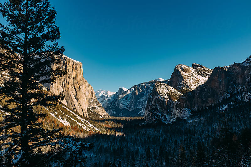 A view of the Yosemite Valley in winter. by Lucas Saugen for Stocksy United