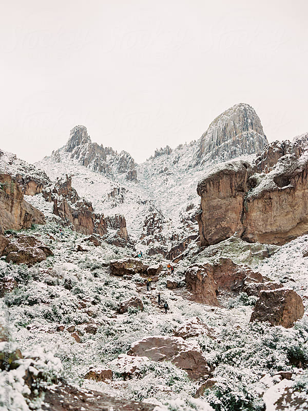 Snowy and rocky  mountains by Daniel Kim Photography for Stocksy United