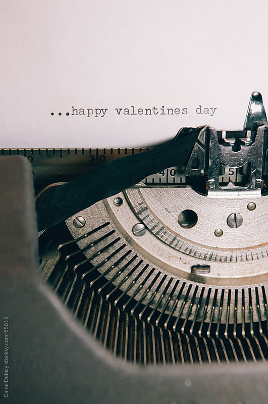 Valentines Day message type on paper using an old typewriter by Caine Delacy for Stocksy United