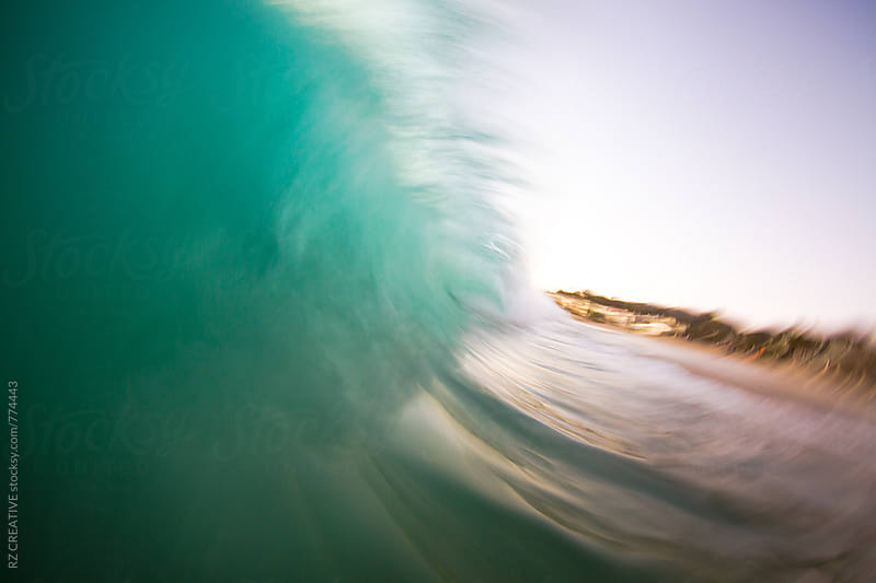 Slow shutter speed/water shot of a breaking wave at sunset. by RZ CREATIVE for Stocksy United
