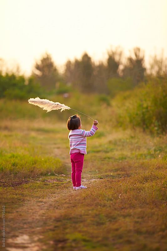 one little asian girl outdoor in the autumn rural by Bo Bo for Stocksy United