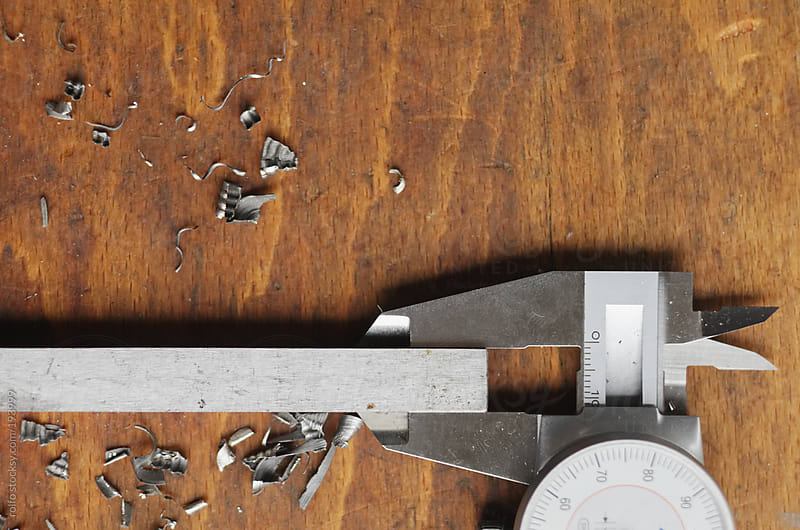 slide gauge on workbench close up by rolfo for Stocksy United