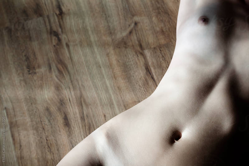 Nude Torso on Parquet Floor by Eldad Carin for Stocksy United