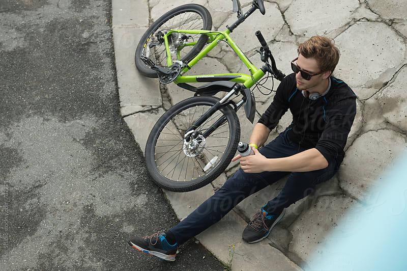 Man resting near bike by Milles Studio for Stocksy United