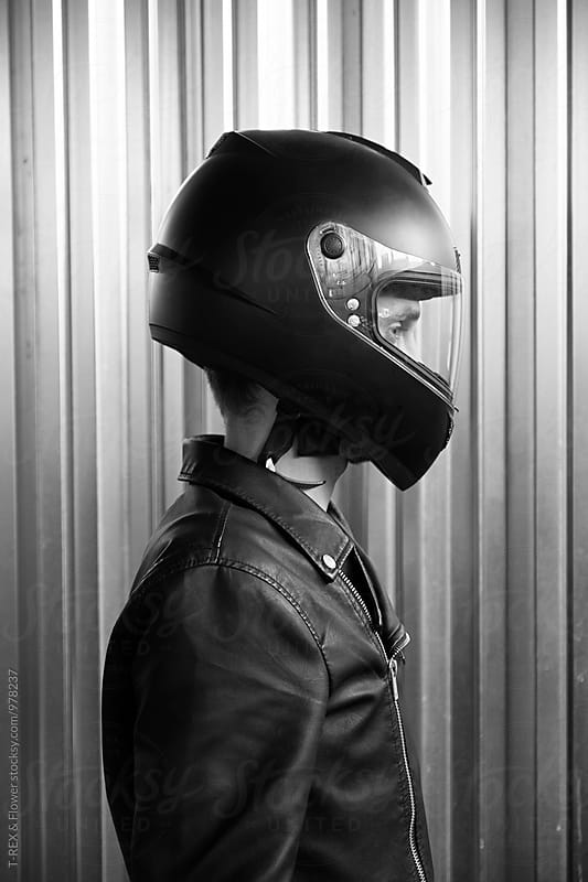 Side view of motorcyclist in helmet by Danil Nevsky for Stocksy United
