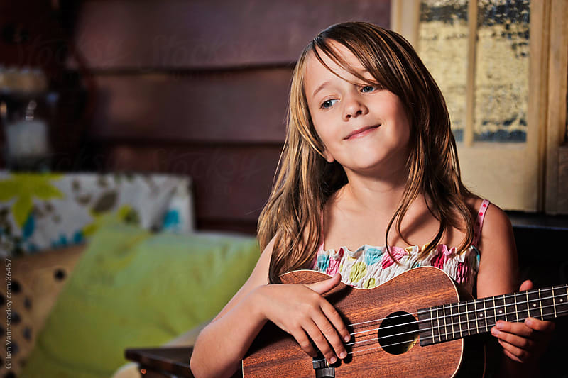 girl playing ukulele by Gillian Vann for Stocksy United