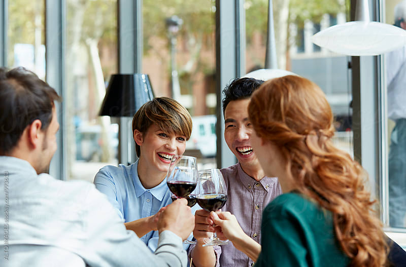 Couple Toasting Wine With Friends In Restaurant by ALTO IMAGES for Stocksy United