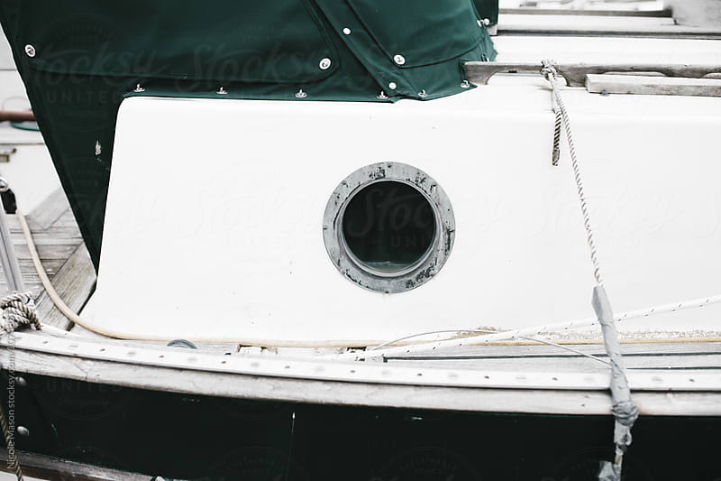 round window on boat by Nicole Mason for Stocksy United