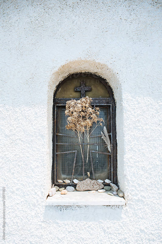 Church wall with window in Greece by Alberto Bogo for Stocksy United