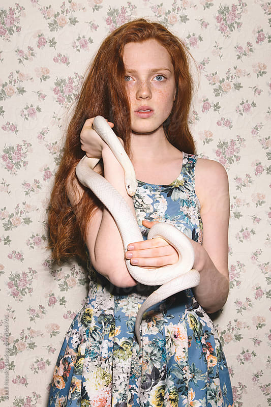 Red-headed young woman holding white snake by Danil Nevsky for Stocksy United