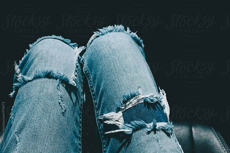 Woman's legs in frayed denim pants by Jacqui Miller for Stocksy United