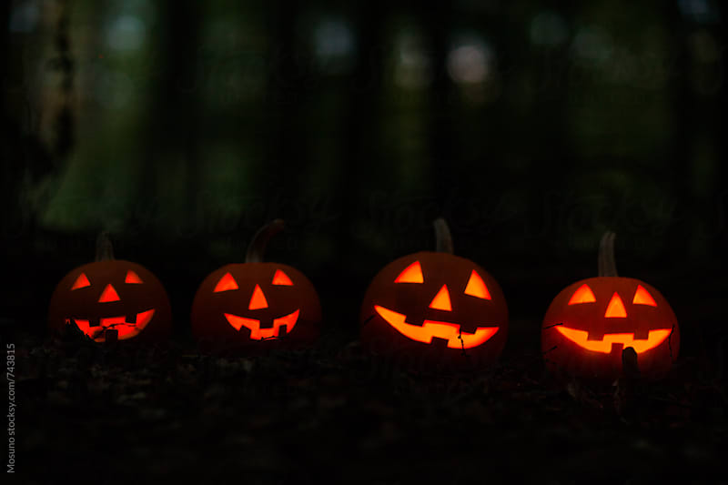 Halloween Pumpkins Glowing in Dark by Mosuno for Stocksy United
