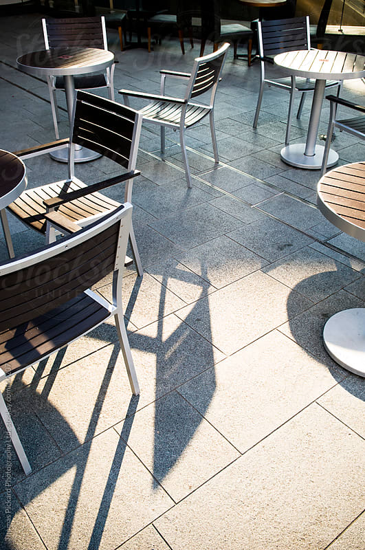 Empty tables and chairs, outdoor cafe, Tokyo, Japan. by Thomas Pickard for Stocksy United
