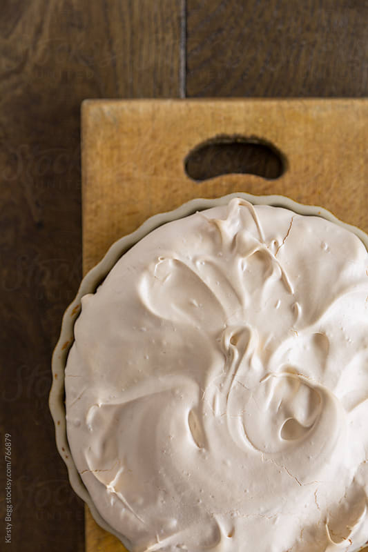 Meringue topped pumpkin pie, overhead by Kirsty Begg for Stocksy United