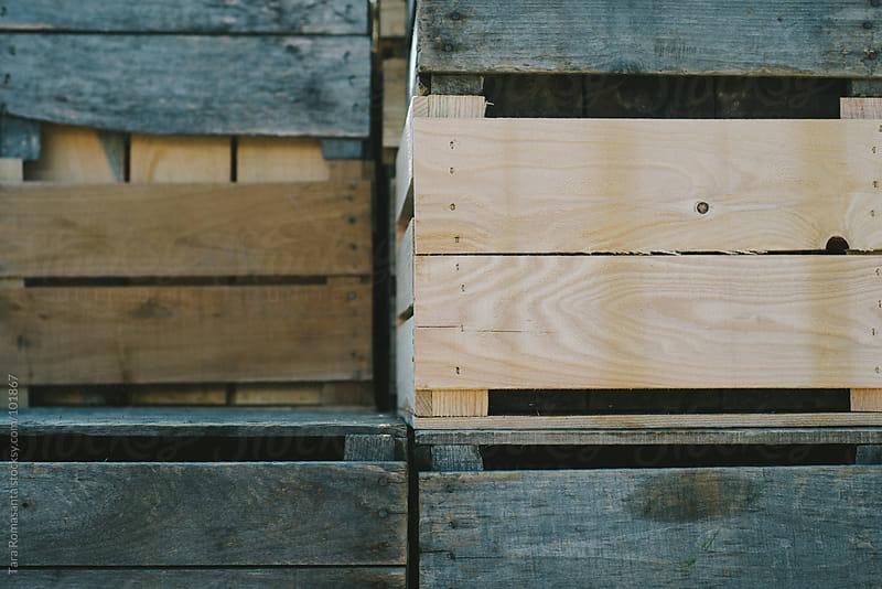empty crates stacked at the farmers market by Tara Romasanta for Stocksy United