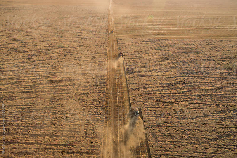 Aerial view of combine harvester in field by Pixel Stories for Stocksy United