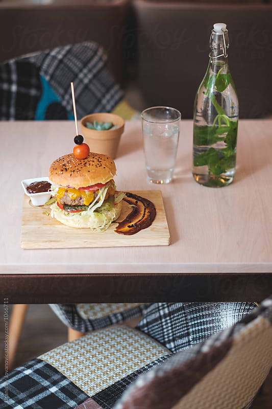 Beef Burger on the Table at the Restaurant by Branislav Jovanović for Stocksy United