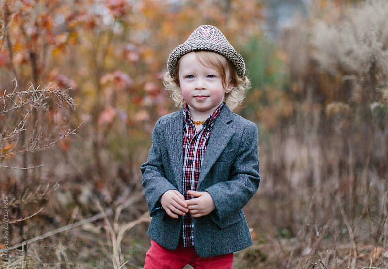 Portrait of a young boy wearing a fedora hat and blazer by Jakob for Stocksy United