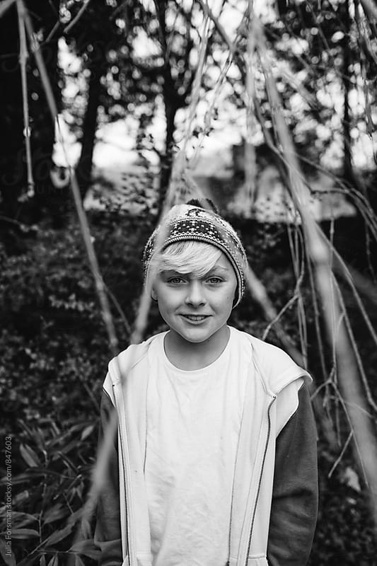 Black and white of cool pre-teen boy. by Julia Forsman for Stocksy United