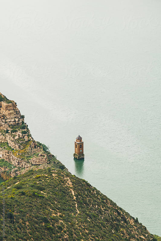 church under the lake by Javier Pardina for Stocksy United