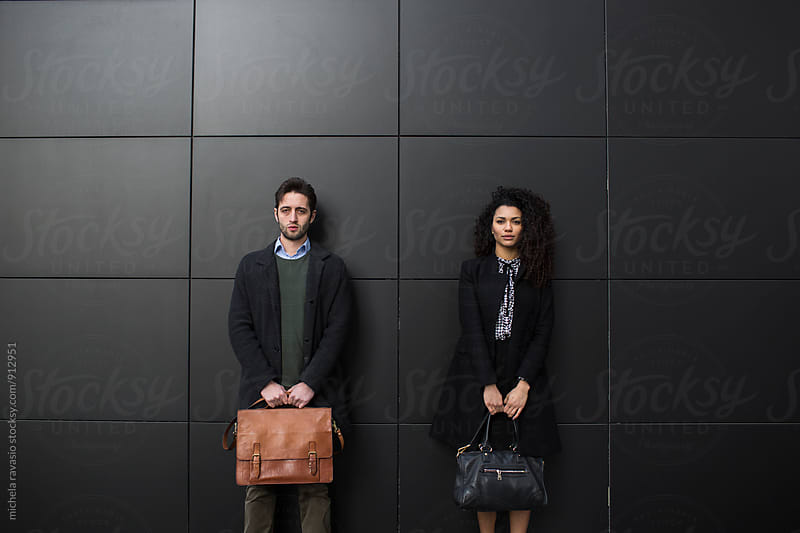 Portrait of a young business couple looking at camera by michela ravasio for Stocksy United