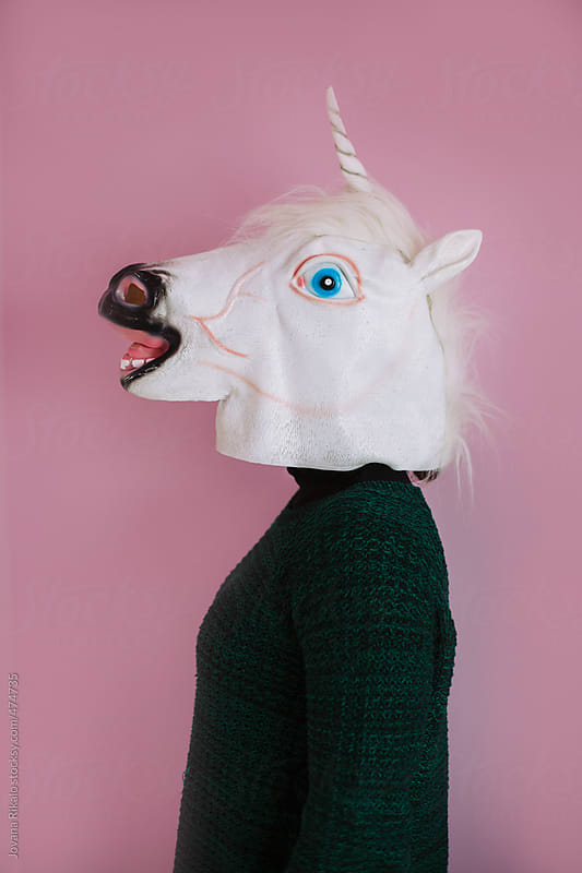 Portrait of a woman in a unicorn mask  by Jovana Rikalo for Stocksy United