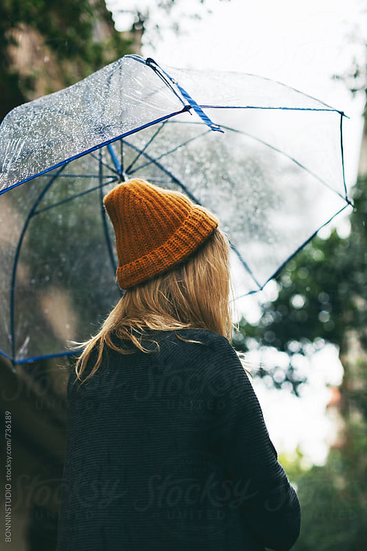 Woman with an umbrella in a rainy day. by BONNINSTUDIO for Stocksy United