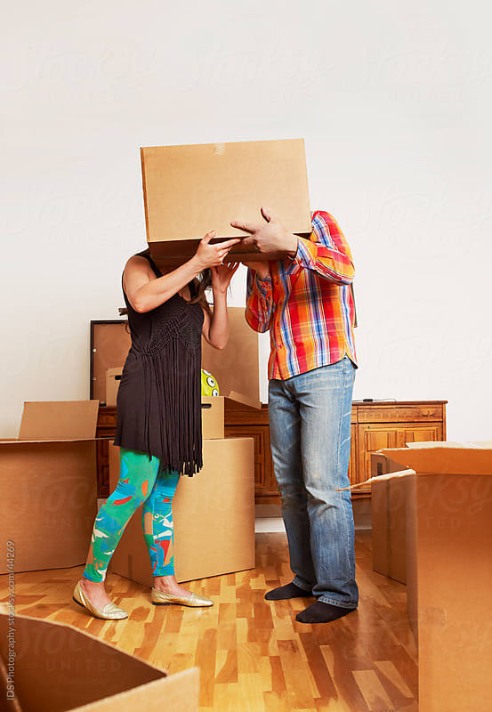 Couple in a new home after moving. by IDS Photography for Stocksy United