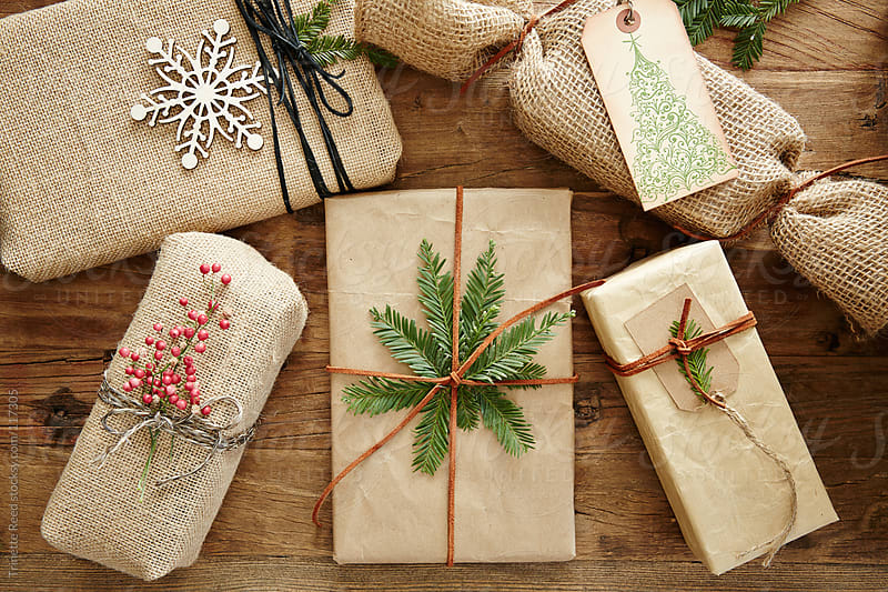 Still life of group of homemade wrapped holiday presents  by Trinette Reed for Stocksy United