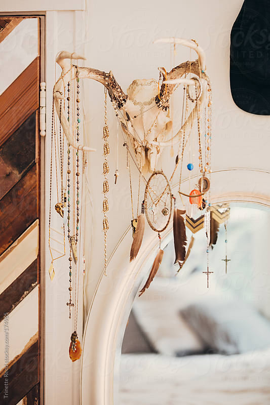 Jewelry hanging on skull in bedroom by Trinette Reed for Stocksy United