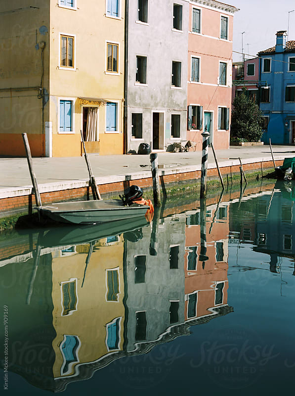 Colourful houses and their reflections in Burano, Venice by Kirstin Mckee for Stocksy United