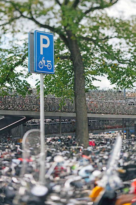 Europe, Netherlands, Holland, Amsterdam, Bicycle park in cental Amsterdam outside the main train station by Gavin Hellier for Stocksy United