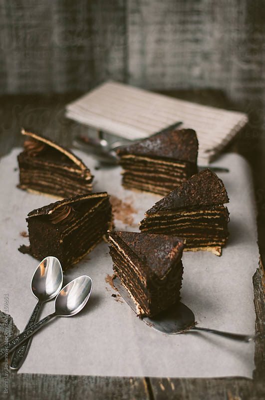 Slices of chocolate cake on the baking paper by Branislav Jovanovic for Stocksy United