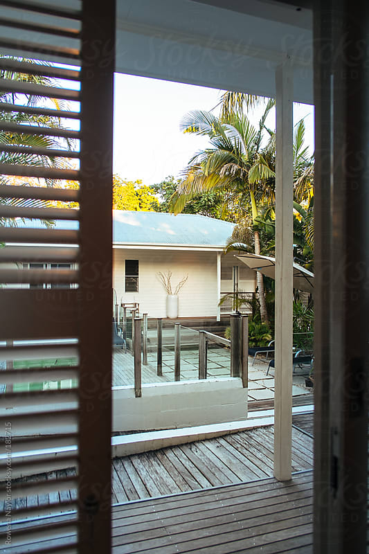 Looking out onto a deck by Rowena Naylor for Stocksy United