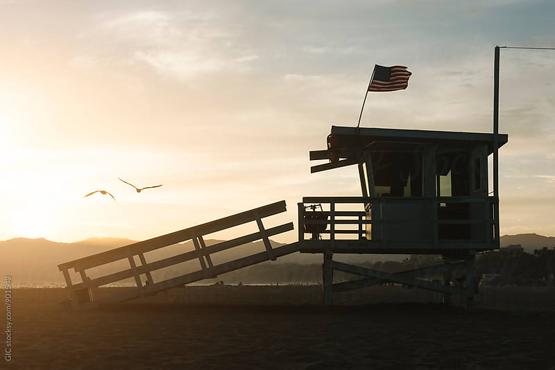 Life guard tower at sunset by GIC for Stocksy United