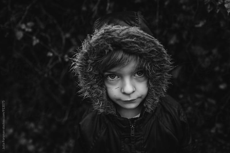 Big eyed boy in a hooded parka. by Julia Forsman for Stocksy United