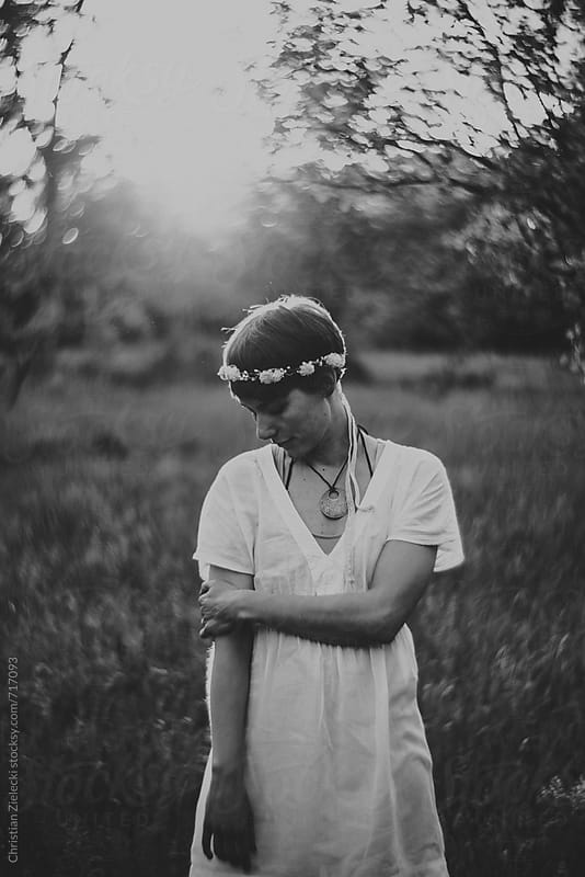 a girl with a flower crown on a meadow by Christian Zielecki for Stocksy United
