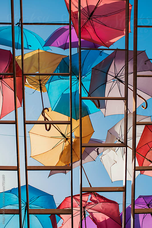 Colorful umbrellas on the street from below by Maja Topcagic for Stocksy United
