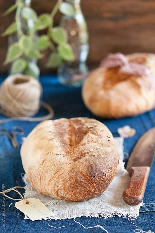 bread on a denim background by Laura Adani for Stocksy United