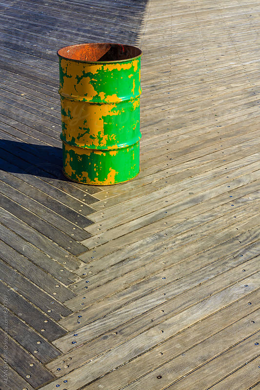 Garbage can on boardwalk by alan shapiro for Stocksy United